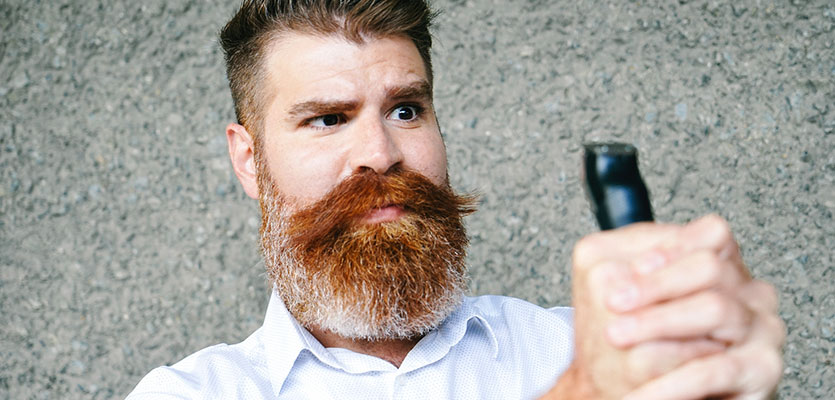 Bearded man resists electric trimmer employer instructs him to shave for safety reasons.